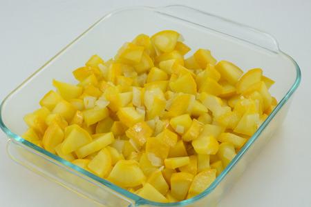 Chopped yellow squash in baking dish