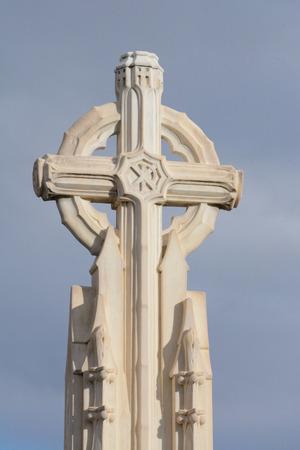 Stone Christian memorial cross with Christogram XP