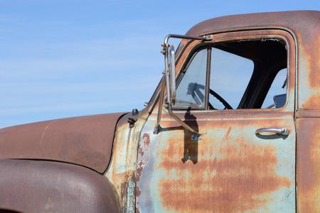 vintage truck: Old rusting vintage truck against blue sky Stock Photo