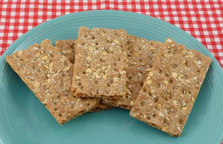 multi grain: Multi grain whole grain crispbread crackers on blue plate