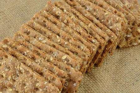 multi grain: Multi grain whole grain crispbread crackers on burlap