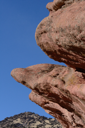 morrison: View of Rocky Mountain foothill through eroded sandstone at Red Rocks Park, Colorado