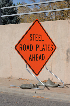 road ahead: Road construction warning sign for steel plates on road ahead