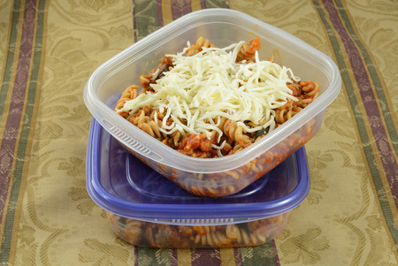 shredded cheese: Putting casserole leftovers into plastic containers for work lunches or for freezing with shredded cheese as extra