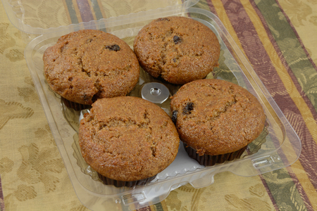 Bakery package of four raisin bran muffins Stok Fotoğraf