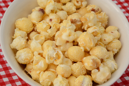 Close up of Caramel popcorn in white bowl Stock Photo