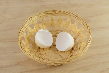 Cracked eggshell in wooden wiker basket