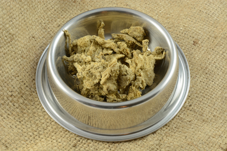 Dried crushed beef tripe dog or cat food and treat for dogs and cats in stainless steel pet bowl