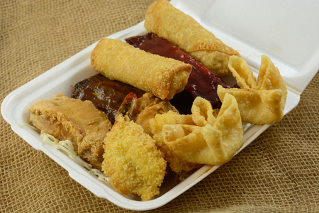 Chinese food take out Pu Pu Platter for two with cheese wontons, fantail shrimp, egg rolls, chicken wings, beef skewers, BBQ spare ribs