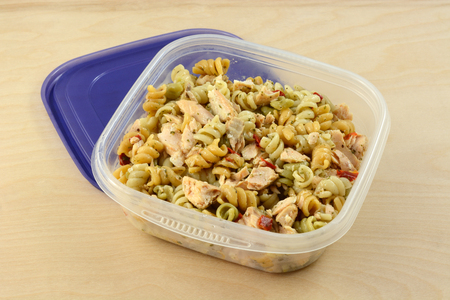 Baked salmon pasta salad with spiral rotini vegetable pasta in plastic storage container Reklamní fotografie