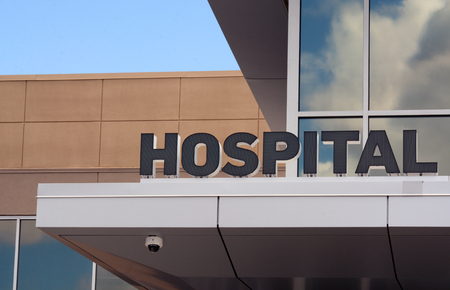 Hospital sign at entrance of small hospital building