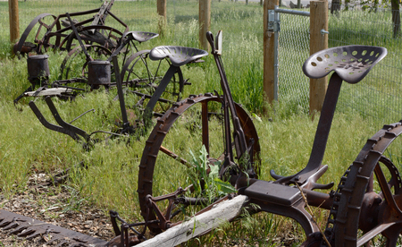 Antique rusty farm plows and agricultural machinery