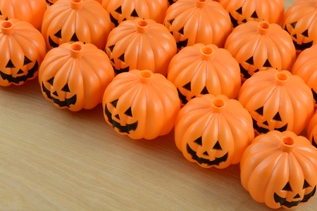Plastic jack o lantern Halloween decorations lined up in rows