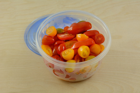 Food Preparation Done In Advance Of Halved Cherry Tomatoes In