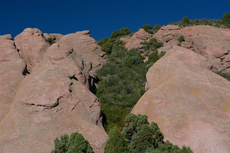 geological rock formations in Red Rocks Park Colorado with background of Rocky Mountain foothills
