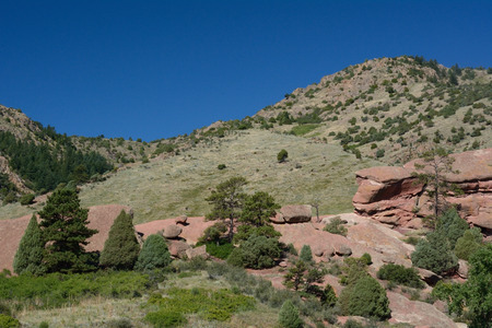 morrison: geological rock formations in Red Rocks Park Colorado with background of Rocky Mountain foothills