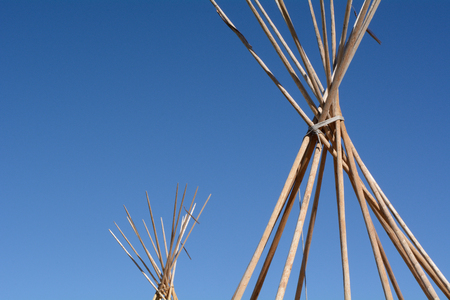 Winter brings end of camping season with bare tipi poles Stock Photo