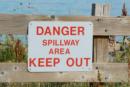 Danger dam spillway sign