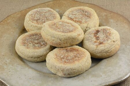Brunch ceramic serving platter of uncooked whole wheat English muffin 写真素材