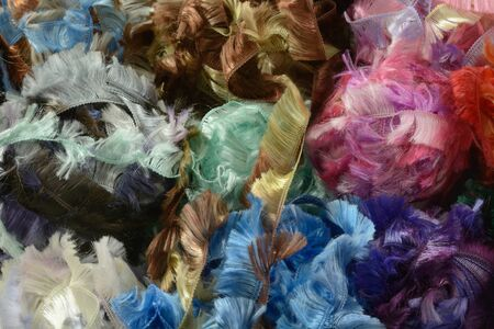 Close up of multicolor balls of fluffy yarn or ribbon