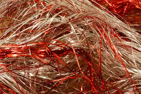 Red and silver tinsel strand background creating concept of movement or storm of motion
