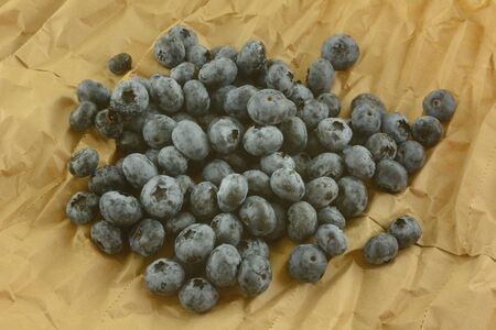 Bunch of freshly rinsed raw blueberries on brown grocery paper Reklamní fotografie