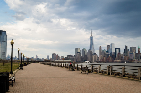 Jersey City, NJ  USA - March 2016: the City of New York as seen from Liberty State Park at the spring cloudy day.