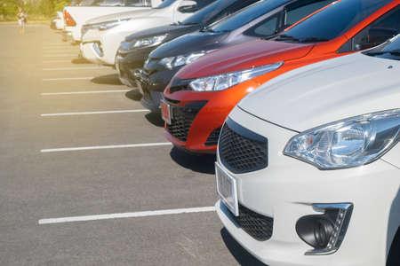 Car parking in parking lot. cars parked at outdoor parking lot, front car close up, automobile transportation dealer business, selective focus