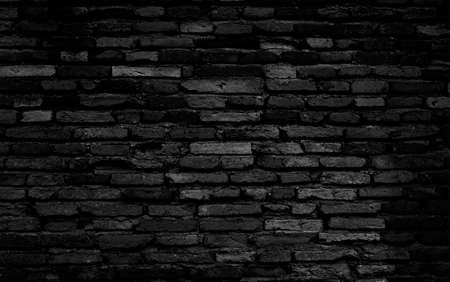 Old black brick wall texture background, black stone block wall texture, rough and grunge surface as used for background, wallpaper and graphic web design Imagens