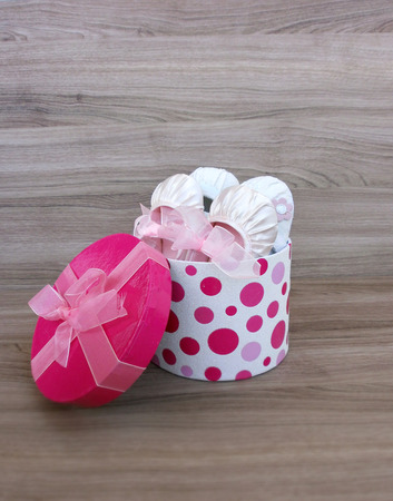 Baby girl shoes in a gift box  photo