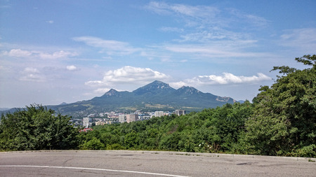 Beautiful view of Beshtaw mountains near Pyatigorsk city, blue summer sky, clouds, 3 tops of mountains