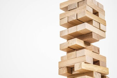 wood blocks tower game. planning, strategy and risk for business and finance. isolated background