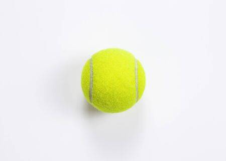 Single tennis ball isolated white background. Top view Imagens