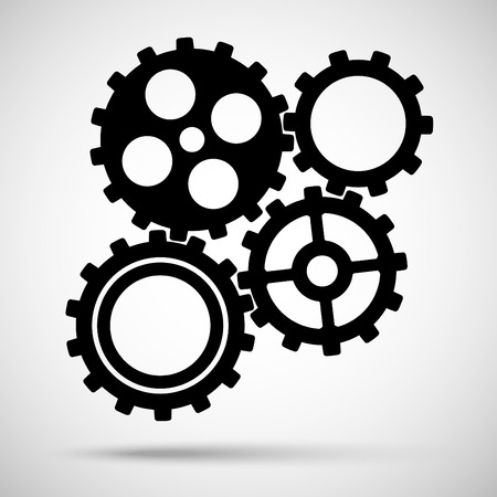 meshed: Black toothed gears is meshed on gray background