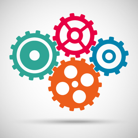 Different colored toothed gears (cogs) is meshed on gray background