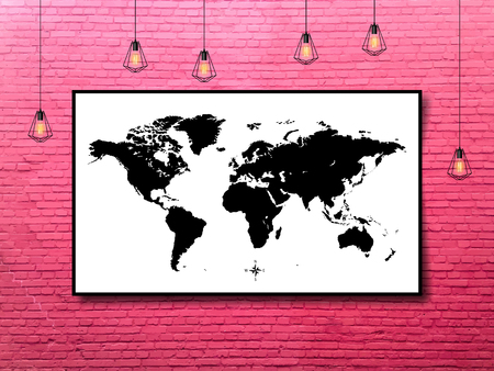 world map in a frame with Edison lamps on a brick wall background in loft style design.