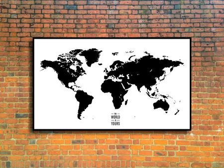 world map in a frame on brick wall background in loft style design.