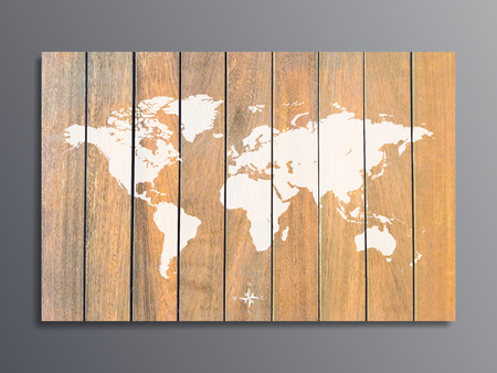 world map on a background texture of wooden boards on grey wall.