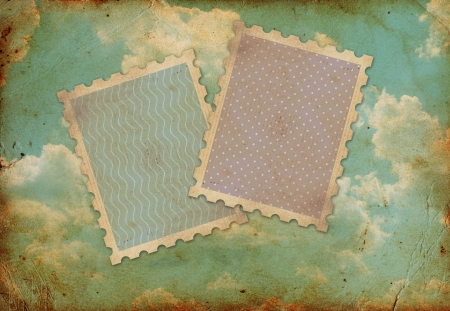two vintage stamps on old photo of sky