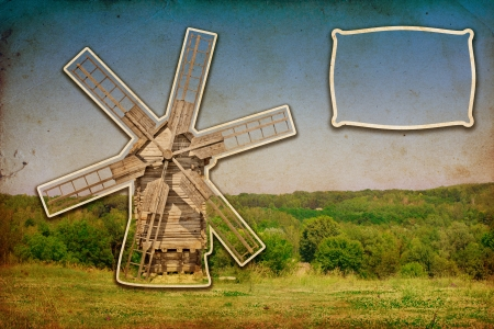 wooden windmill cut from old photo with place for text photo