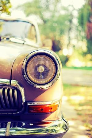Close-up photo of retro car headlights