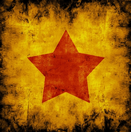 Red star on an orange grunge background photo