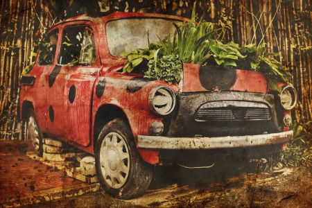capote: Vintage photo, old red car with flowers on capote