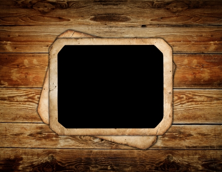 Vintage photo frame on wood background photo