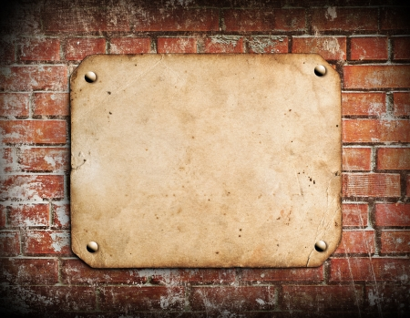 Old paper on brick wall Stock Photo - 15666006
