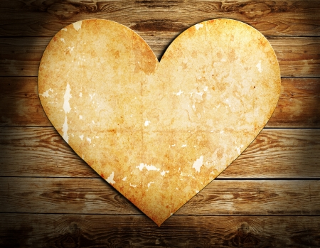 vintage heart made from paper on wooden background Stock Photo - 15665976