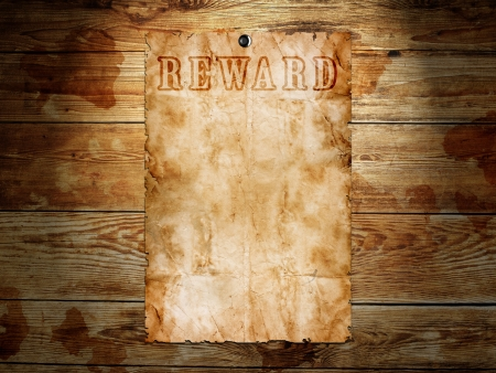 reward: Old western wanted poster on wooden background