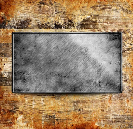 Metal template on old wood plank background Stock Photo - 16931855