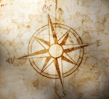 cartographer: Old compass on paper background
