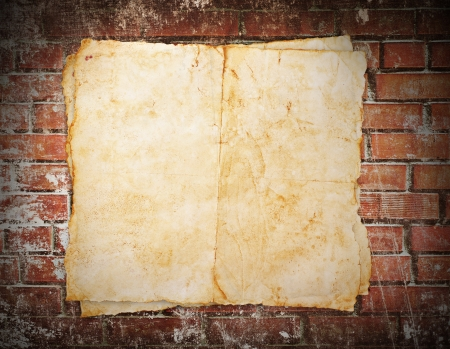 Old paper on brick wall Stock Photo - 17162231